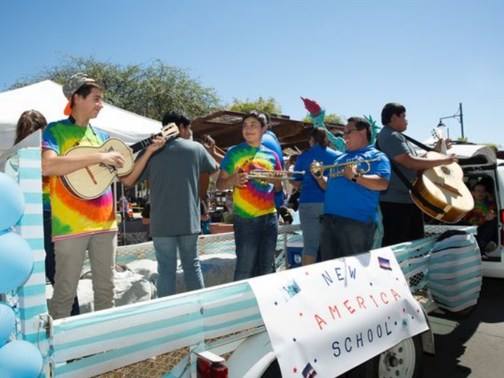 New America School rides a float playing mariachi music Saturday, September 17, 2016, during the Plaza de Las Cruces dedication parade at downtown Main Street.